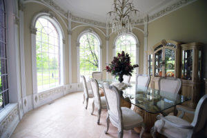 Elegant & Ornate Dining Room by Architectural Justice